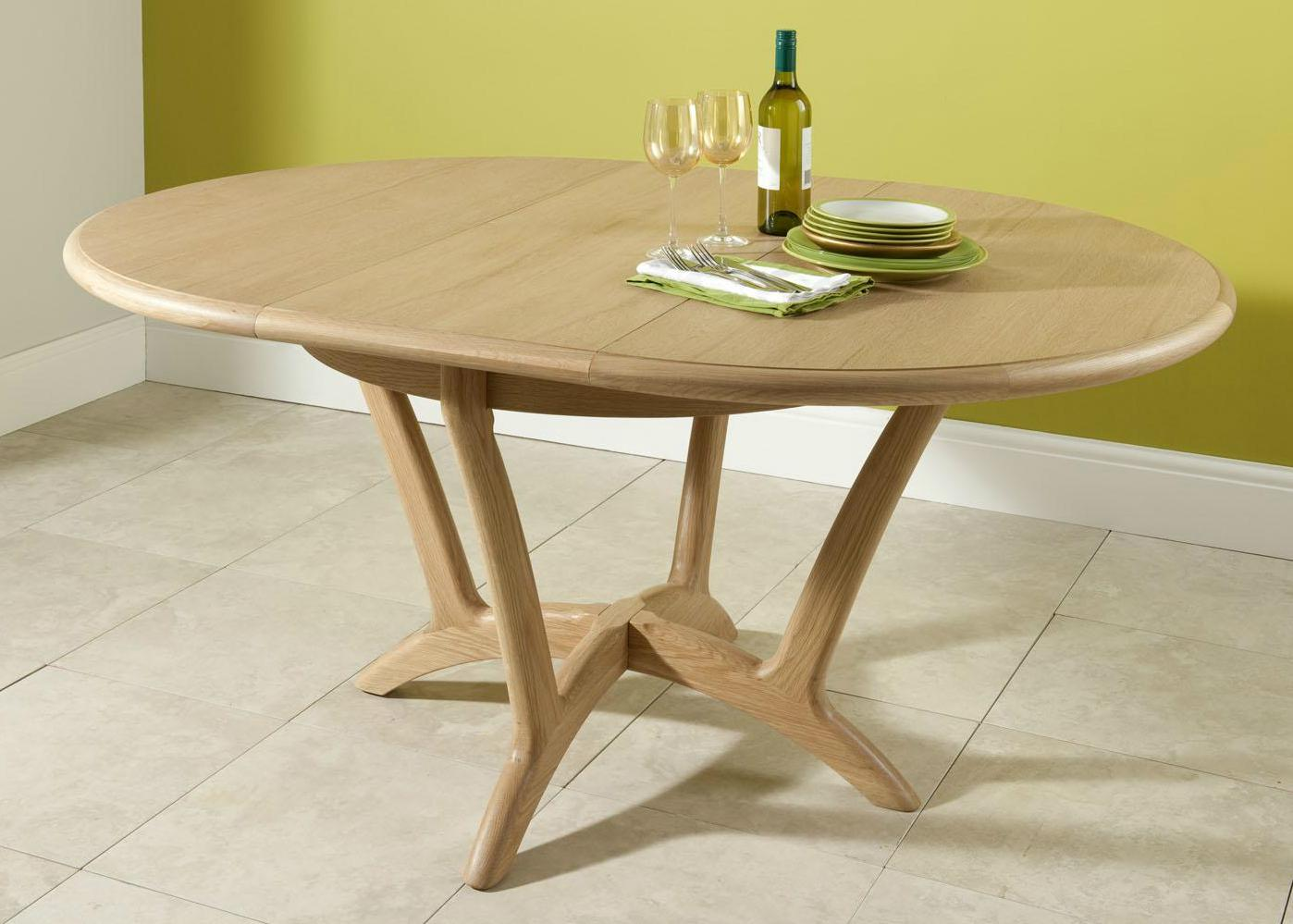 Stockholm oval extending dining table from tannahill furniture ltd
